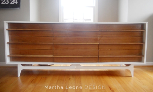 Oversized MCM credenza painted a glossy white. The drawers were stripped and raw wood color was sealed with a glossy finish.